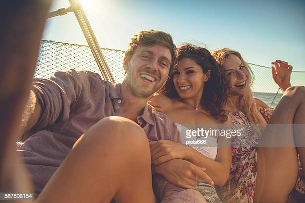 Friends summer vacation: selfie on a sailing yacht