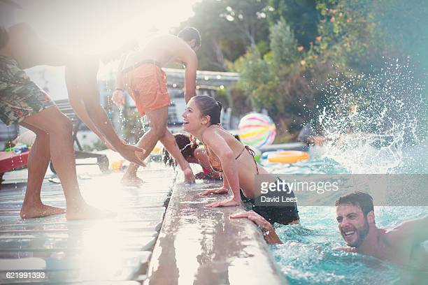 friends swimming in pool at pool party - pool party stock pictures, royalty-free photos & images