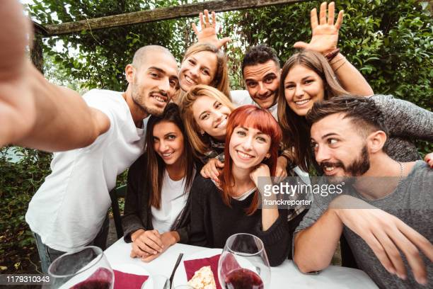 friends take a selfie at the restaurant - amizade imagens e fotografias de stock