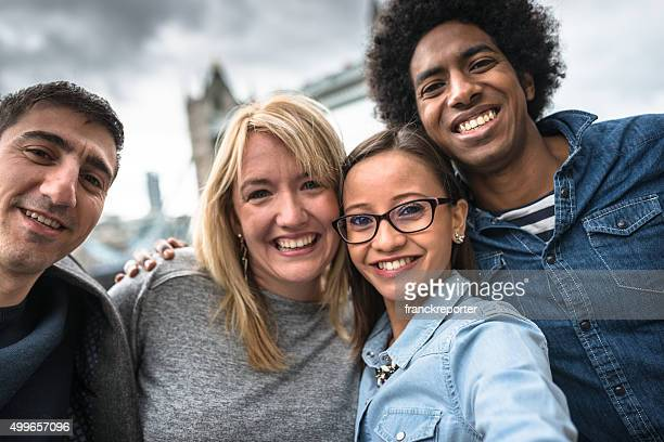 friends take a selfie in london - Tower bridge