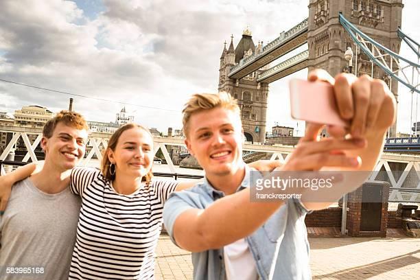 friends take a selfie in london - Tower bridge