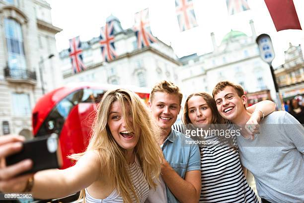 friends take a selfie in piccadilly circus