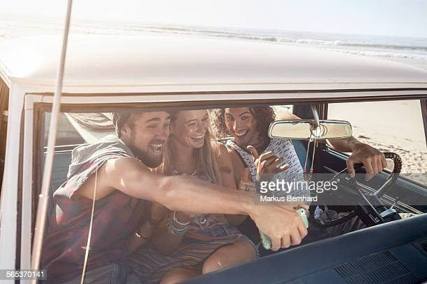 Friends take a selfie in their pickup truck