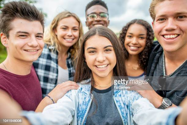 Friends take a selfie together outside