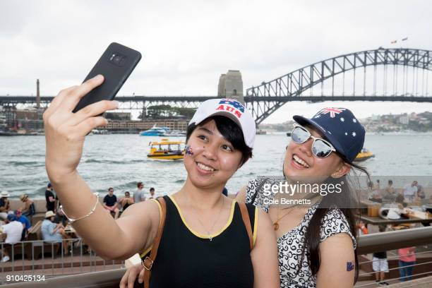 Friends take selfies at the Australia Day Celebration in Circular Quay on January 26 2018 in Sydney Australia Australia Day formerly known as...