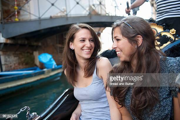 Friends taking a gondola ride in Venice