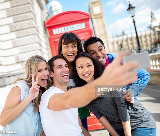 Friends taking a picture in London