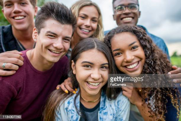 friends taking a picture together - 20 24 years stock pictures, royalty-free photos & images
