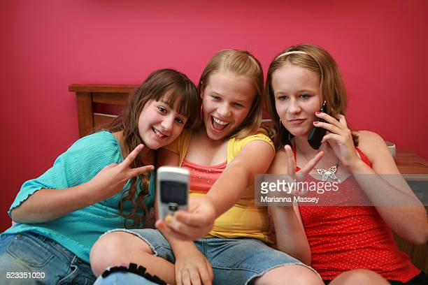 Friends taking a picture with a camera phone