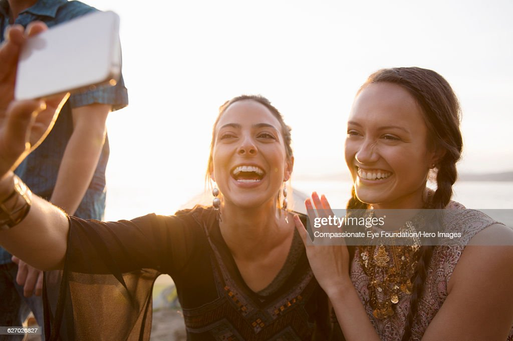 Friends taking a self portrait on beach : Stock Photo
