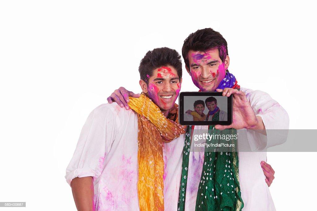 Friends taking a self portrait : Stock Photo
