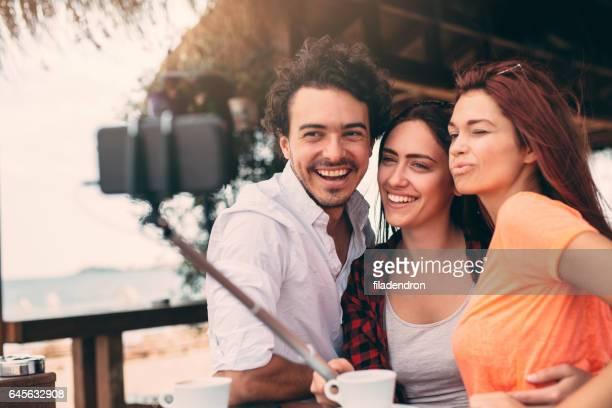 Friends taking a selfie at a beach bar