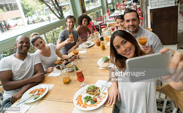 friends taking a selfie at a restaurant - family reunion stock pictures, royalty-free photos & images