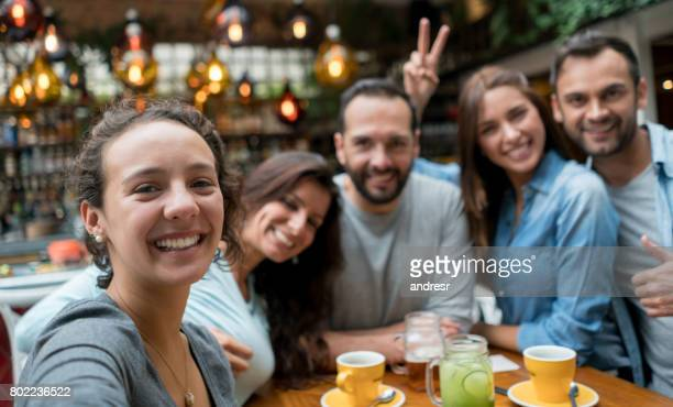 friends taking a selfie at a restaurant - self portrait stock pictures, royalty-free photos & images