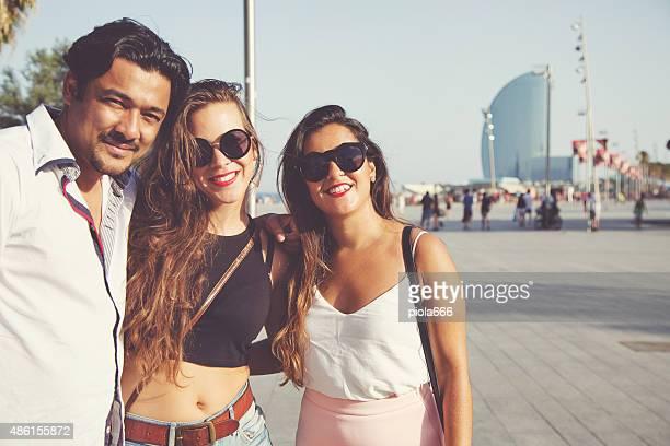 Friends taking a selfie at Barceloneta