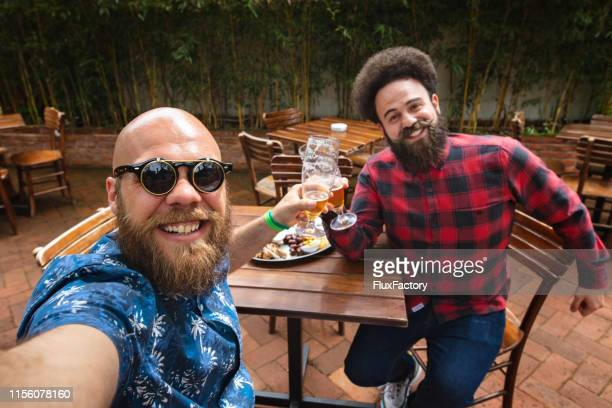 friends taking a selfie at the bar - best sunglasses for bald men stock pictures, royalty-free photos & images