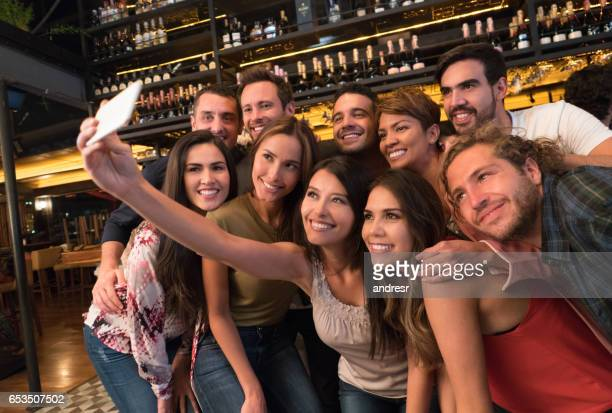 Friends taking a selfie at the bar