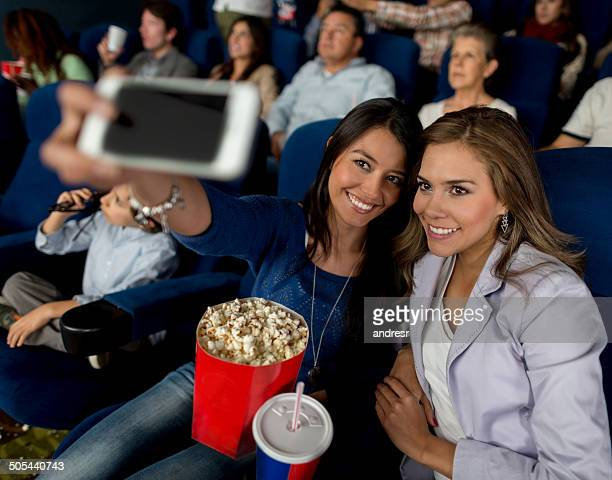 Friends taking a selfie at the movies