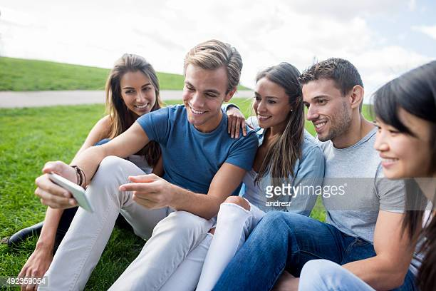 Friends taking a selfie at the park