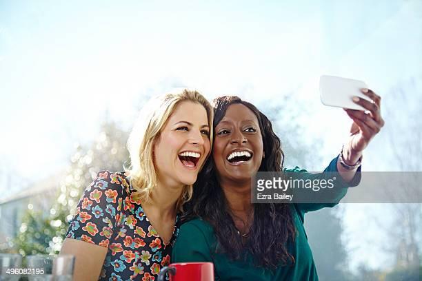 Friends taking a selfie in a coffee shop