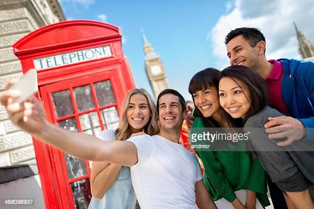 Friends taking a selfie in London