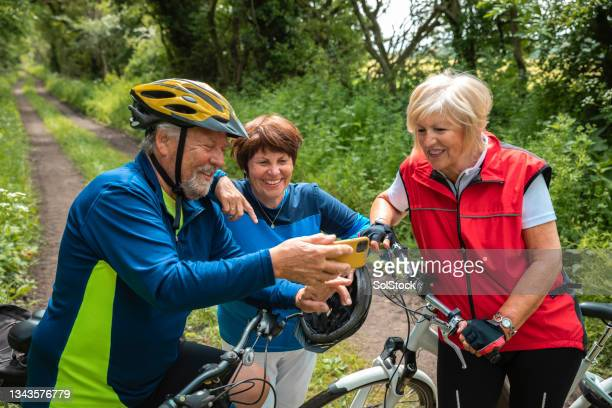 friends taking a selfie on a bike ride - morpeth stock pictures, royalty-free photos & images