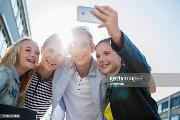 Friends taking a selfie outdoors