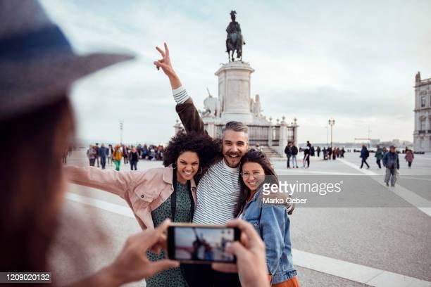 friends taking a selfie - praça do comércio imagens e fotografias de stock