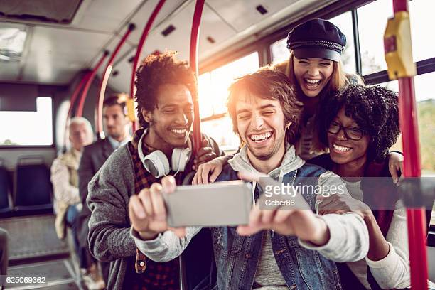 friends taking a selfie - bus stock photos and pictures