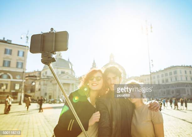 friends taking a selfie stick in rome - stick stock photos and pictures