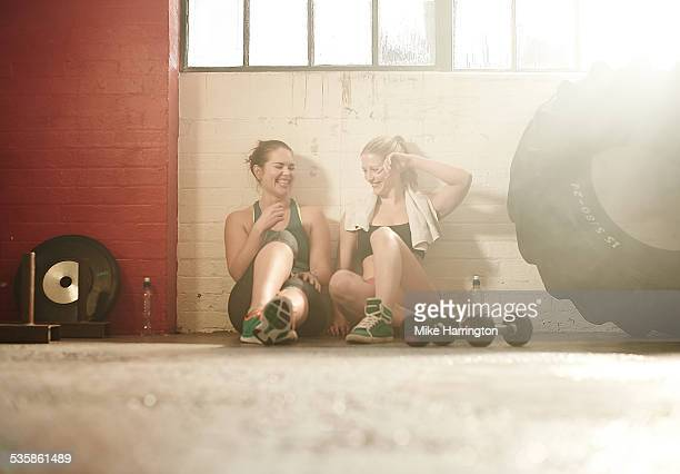 Friends taking break after workout in gym