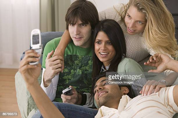 Friends taking picture with a camera phone