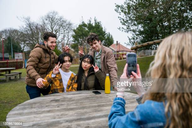 friends taking pictures - alternative pose stock pictures, royalty-free photos & images