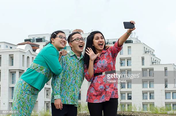 Friends taking pictures (selfie)