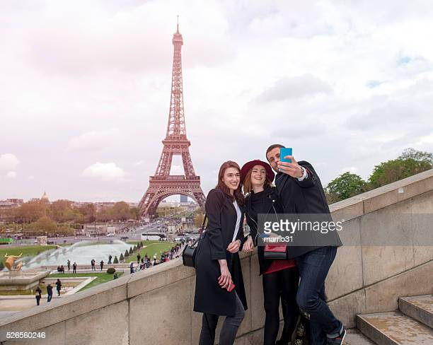Friends taking self pictures in paris