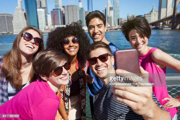 Friends taking self portrait with Manhattan Skyline