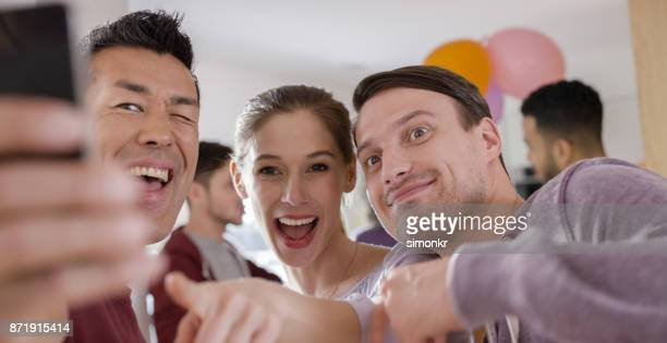 Friends taking selfie at birthday party