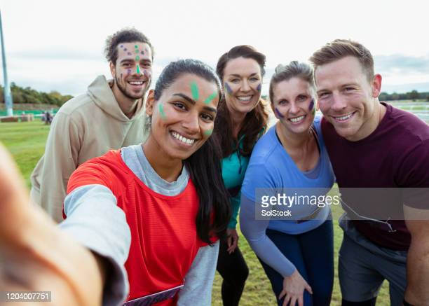 friends taking selfie before fundraising charity run - fundraising stock pictures, royalty-free photos & images