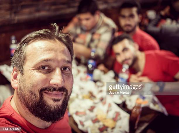 friends taking selfie during dinner - iftar stock pictures, royalty-free photos & images