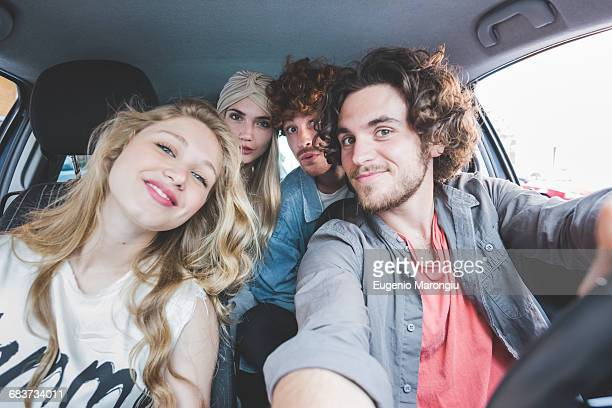 Friends taking selfie in car