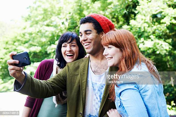 friends taking selfie in park