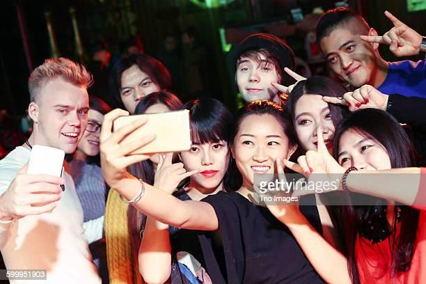 friends taking selfie in pub