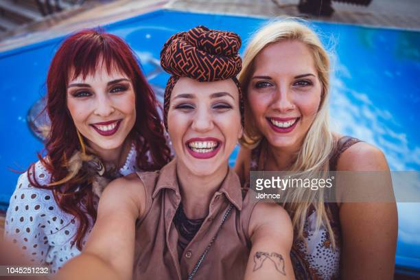 friends taking selfie in the amusement park - camera point of view stock photos and pictures