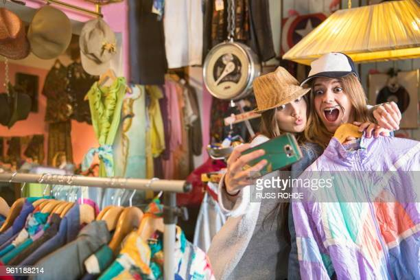 friends taking selfie in thrift store - digital native stock pictures, royalty-free photos & images
