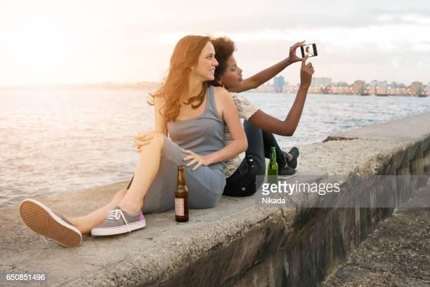 friends taking selfie, Malecon, Havana, Cuba