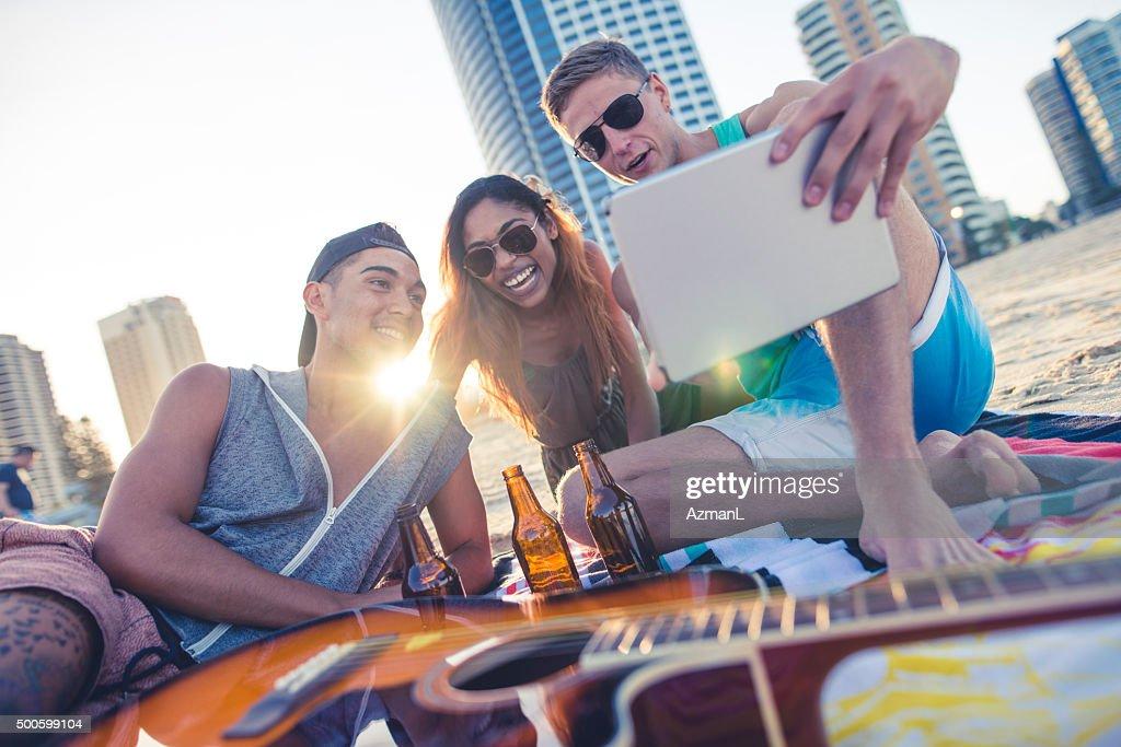 Friends taking selfie on beach : Stock Photo