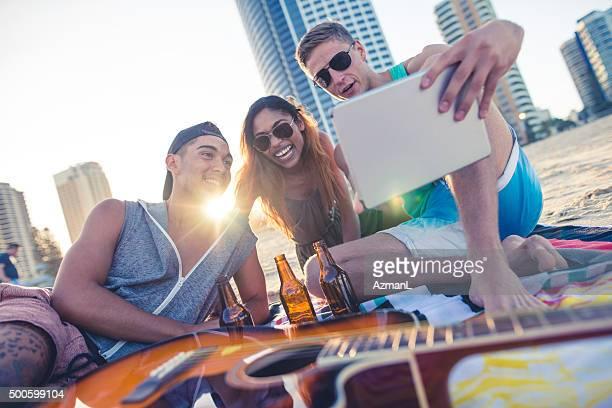 Friends taking selfie on beach