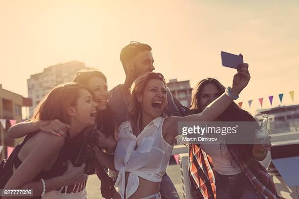 Friends taking selfie on rooftop terrace