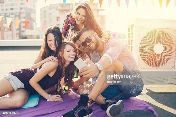 Friends taking selfie on the rooftop
