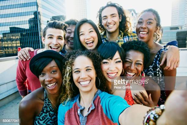 friends taking selfie on urban rooftop - ethnicity stock pictures, royalty-free photos & images